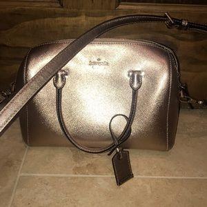 Rose gold Kate spade purse